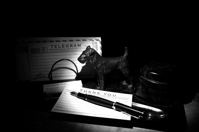 My desktop ink pen, inkwell, and tube tickets.