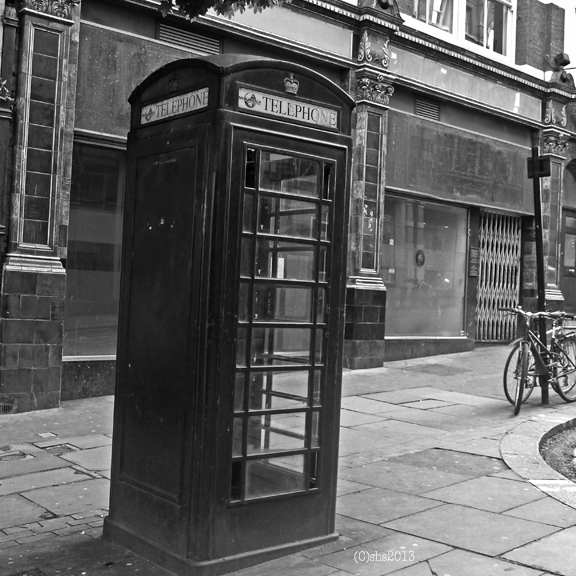 photograph black and white by susan sheldon nolen of london phone box near charring cross