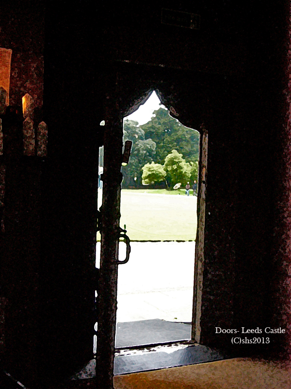 Photograph of a door at leeds castle looking out into the garden by susan sheldon nolen 2013