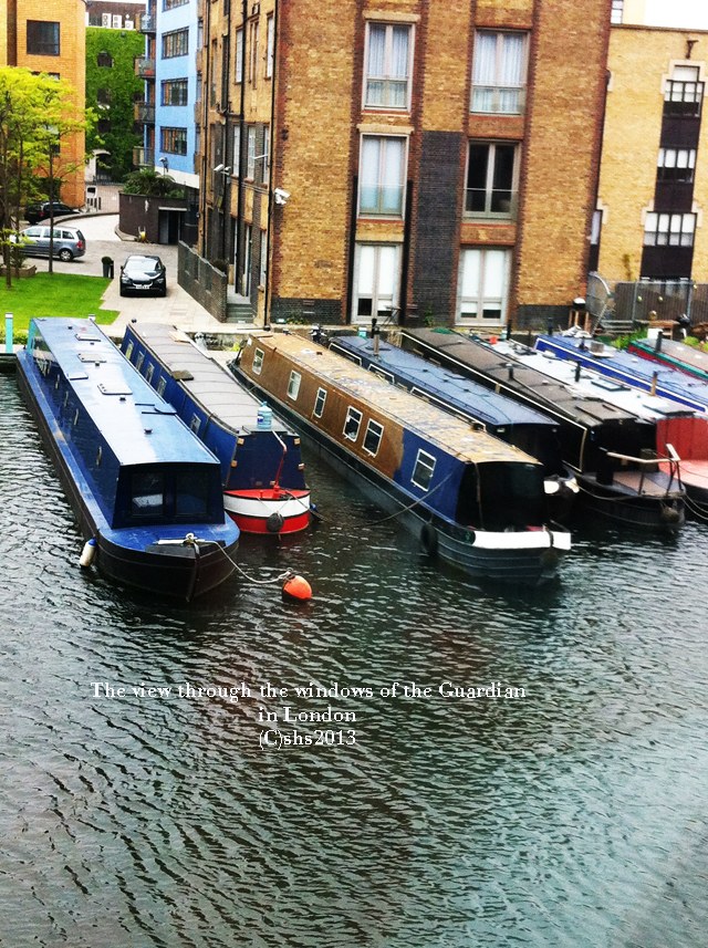 Photograph of canal boats as seen through the windows of the offices of the guardian in london by susan sheldon nolen (C)2013