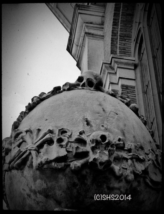back and white photography by susan sheldon nolen of skull in front of church