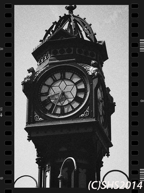 Black and white photograph of a clock tower by susan sheldon nolen
