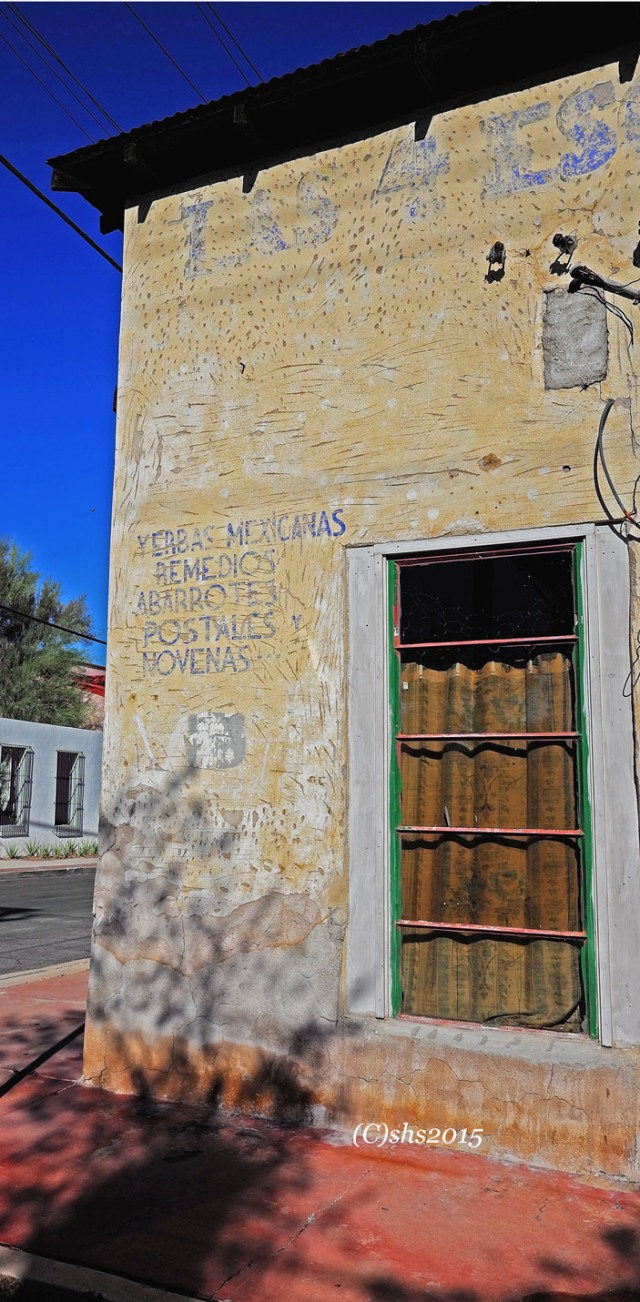 Photograph of a faded sign on a house in tucson arizona by susan sheldon nolen