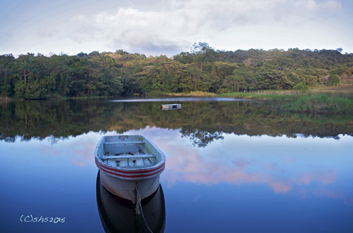 susan nolen's photograph of a boat on the lake on Rancho Primavera