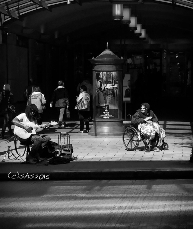 Susan Nolen's Photograph of the homeless in Seattle enjoying the music of a busker